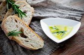 Fresh bread with olive oil and rosemary