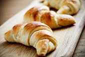 image of french pastry  - Fresh homemade croissants on wooden table - JPG