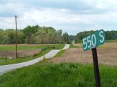 Hilly Country Road With Sign