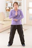 image of qi  - Beautiful woman doing qi gong tai chi exercise at home - JPG