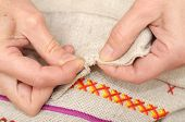picture of thread-making  - Woman hands sewing with needle and thread - JPG