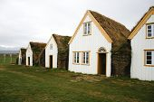 stock photo of iceland farm  - Traditional turf houses in a row in Iceland - JPG