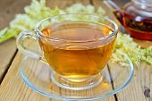 foto of meadowsweet  - Meadowsweet tea from a glass cup and teapot - JPG