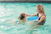 Happy mother and daughter in the swimming pool at the leisure center
