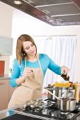 Cooking - Young Woman With Spaghetti On Stove poster