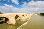 Old Roman Bridge Over The Guadalquivir River In Cordoba, Spain