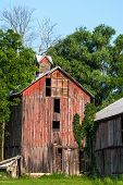 stock photo of neglect  - Abandoned and Neglected Red Barn in Disrepair - JPG