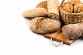 foto of bread rolls  - Composition with bread and rolls in wicker basket isolated on white - JPG