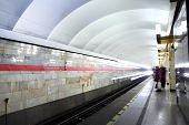 Russia, St. Petersburg, Passengers Stand On The Platform Subway Station.