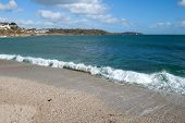 The Shore Of Gyllyngvase Beach, Falmouth Cornwall.