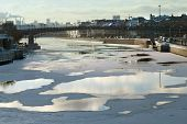 Ice floating on the river in winter