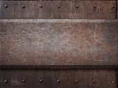 picture of ironclad  - rusty tank armor metal texture with rivets as steam punk background - JPG