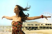 image of open arms  - Young casual caucasian woman standing eyes closed arms wide open at summer holiday beach - JPG