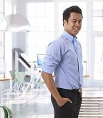 stock photo of entrepreneur  - Portrait of successful young asian entrepreneur at office - JPG