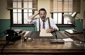 picture of mouth  - Shocked vintage businessman with mouth open working at desk and checking paperwork - JPG