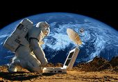 foto of solar battery  - Astronaut on his knees near the solar battery - JPG