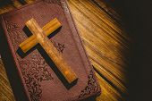 image of crucifix  - Crucifix icon on the bible on wooden table - JPG