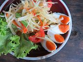 stock photo of green papaya salad  - closed up papaya salad with salted egg