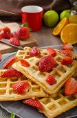 foto of maple syrup  - Homemade waffles with maple syrup and fresh strawberries and oranges - JPG
