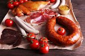 pic of deli  - Assortment of deli meats on parchment on wooden table background - JPG