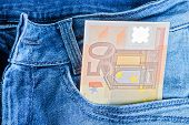 picture of 50s  - 50 Euro banknotes in a blue jeans pocket - JPG