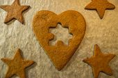 stock photo of ginger bread  - Creative ginger bread baking at Christmas reflects the quest for the missing piece - JPG
