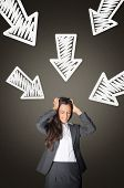 stock photo of pressure point  - Stressed Young Office Woman with Conceptual White Arrows Above Pointing Her on Abstract Gray Gradient Background - JPG
