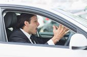 picture of outrageous  - Businessman experiencing road rage in his car - JPG
