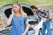 image of breakdown  - Couple after a car breakdown at the side of the road - JPG