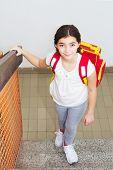 image of ten years old  - Ten year old girl going home from school - JPG