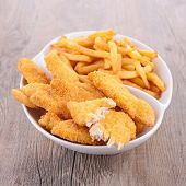 stock photo of french fries  - french fries and chicken breaded fried - JPG