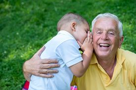 picture of grandparent child  - happy grandfather and child have fun and play in park on beautiful  sunny day - JPG