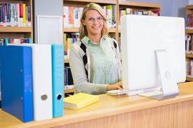 picture of librarian  - Pretty librarian working in the library at the university - JPG