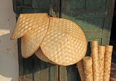 pic of conic  - Woven conical hats are an iconic symbol of South East Asia - JPG