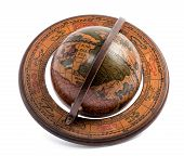 stock photo of continent  - Old vintage wooden terrestrial world globe showing the maps of the continents and oceans for travel geography and navigation lying at an oblique angle over white - JPG