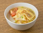 pic of scallion  - Thai Cuisine and Food Thai Omelet Soup with Tomatoes and Chopped Scallion on Wooden Table - JPG