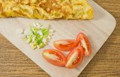 stock photo of scallion  - Thai Cuisine and Food Delicious Thai Omelet with Tomatoes and Chopped Scallion on A Cutting Board - JPG
