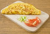 picture of scallion  - Thai Cuisine and Food Thai Style Omelet with Tomatoes and Chopped Scallion on Wooden Board - JPG
