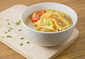 image of scallion  - Thai Cuisine and Food Thai Omelet Soup with Tomatoes Onion and Chopped Scallion on Wooden Cutting Board - JPG
