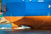 picture of rudder  - Stern of ship with working screw and rudder - JPG