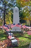 Cemetery Monument With Flags poster
