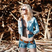 picture of denim jeans  - Beautiful woman in denim jeans shorts and jacket - JPG