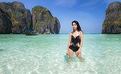 foto of phi phi  - Asian lady relax with long tail boat at maya beach Phi Phi island near Phuket in Thailand - JPG