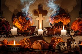 picture of day dead skull  - Traditional mexican Day of the dead altar with pan de muerto and candles - JPG