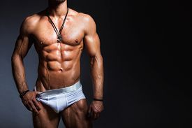 stock photo of panties  - Muscular and sexy torso of young man with perfect muscular body in panties - JPG