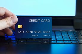 stock photo of payment methods  - Businessman making a credit card payment on the internet - JPG