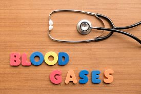 picture of gases  - Blood gases colorful word with stethoscope on the wooden background - JPG