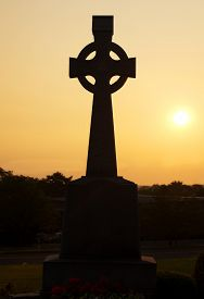 image of celtic  - Celtic cross in silhouette on Tipperary Hill a prodominatly Irish - JPG