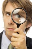 Businessman Looks Through Magnifying Glass