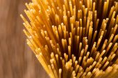 Постер, плакат: Yellow Long Spaghetti Integral On A Rustic Background Yellow Italian Pasta